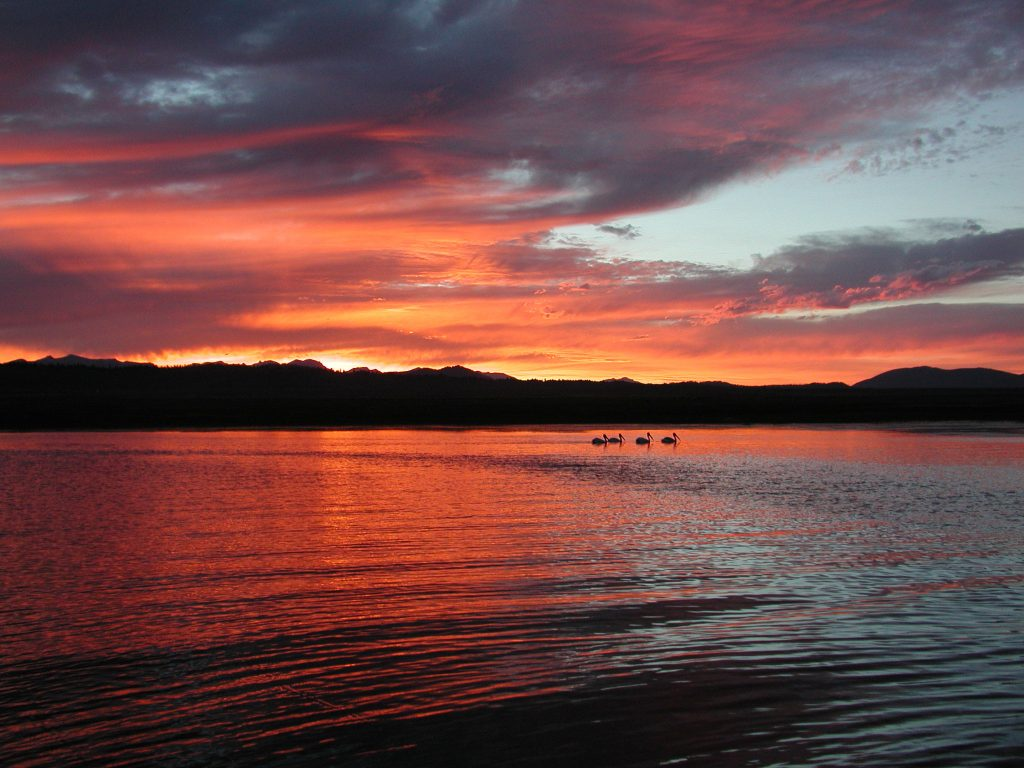 Sunset over Mammoth Lakes while in a boat fly fishing in Crowley Lake
